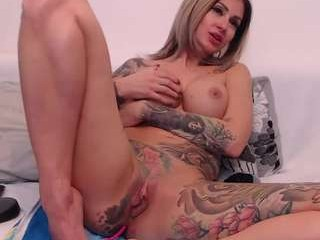yourkat sticks a butt-plug up her anal hole while fucking her soaking wet pussy with a dildo